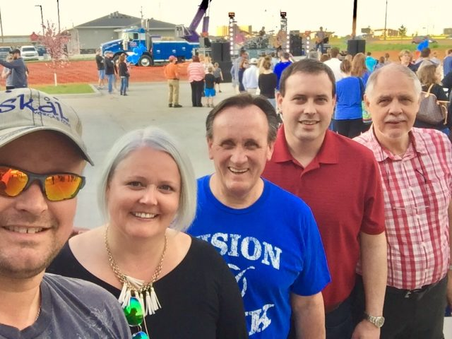 A selfie of 5 people at the VISIONBank opening