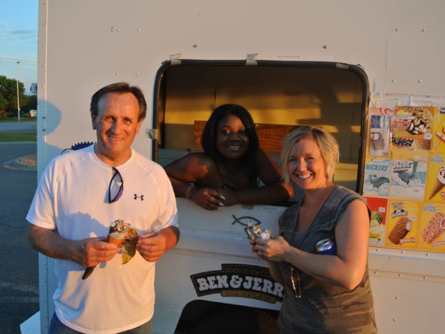 3 people in front of an icecream truck
