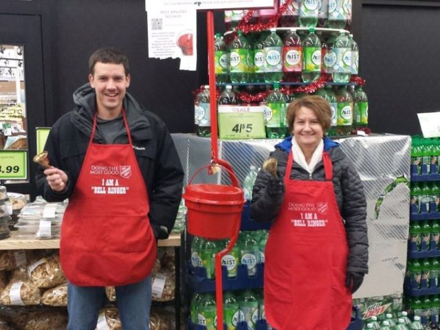 Two people ringing salvation army bells