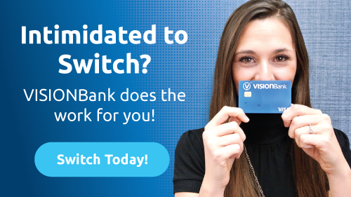 Girl smiling holding a vision bank debit card